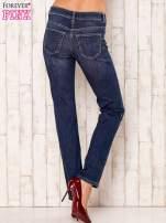 Granatowe proste spodnie jeansowe                                  zdj.                                  3