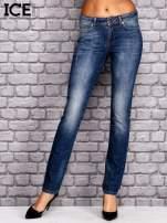 ICEBERG Ciemnoniebieskie spodnie jeansowe z przetarciami                                  zdj.                                  1