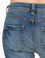 Jasnoniebieskie spodnie jeansowe typu rurki z cieniowaniem