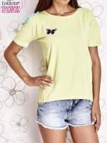 Limonkowy t-shirt z naszywką motyla i pomponami                                  zdj.                                  1