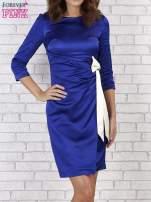 Niebieska sukienka z białą kokardą                                   zdj.                                  4
