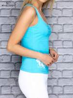 Niebieski top sportowy z siateczką i nadrukiem floral print                                  zdj.                                  3