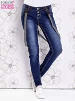 Niebieskie przecierane spodnie jeansowe z szelkami