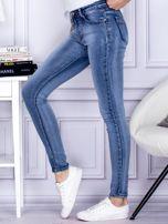 Niebieskie rozjaśniane jeansy rurki                                  zdj.                                  3