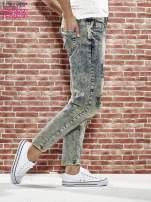 Niebieskie spodnie boyfriend jeans z szarpaniem                                                                          zdj.                                                                         3