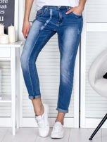 Niebieskie spodnie jeansowe damskie z ozdobnym suwakiem                                  zdj.                                  1