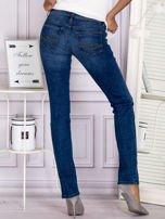 Proste spodnie jeansowe z delikatnymi przetarciami niebieskie                                  zdj.                                  2