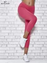 Różowe legginsy sportowe z dżetami na dole nogawki