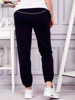 SLAZENGER Granatowe spodnie dresowe                                  zdj.                                  2