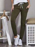 Spodnie dresowe ze ściągaczami i troczkami khaki                                  zdj.                                  1