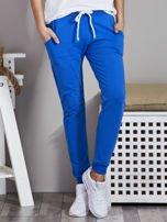 Spodnie dresowe ze ściągaczami i troczkami niebieskie                                  zdj.                                  1