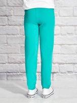 Zielone spodnie dresowe dla dziewczynki z napisem HAPPY                                  zdj.                                  2