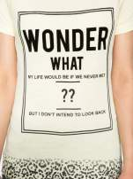 Żółty t-shirt z napisem WONDER WHAT?